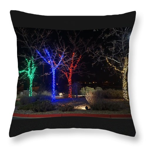 Winter Throw Pillow featuring the photograph Four Lighted Trees by Susan Brown