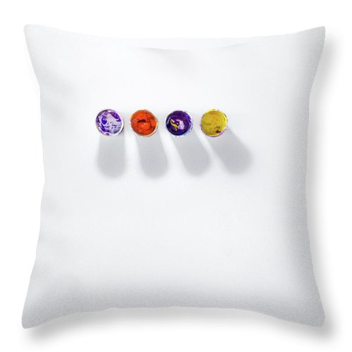 Paint Throw Pillow featuring the photograph Four Small Containers Of Paint by Scott Norris