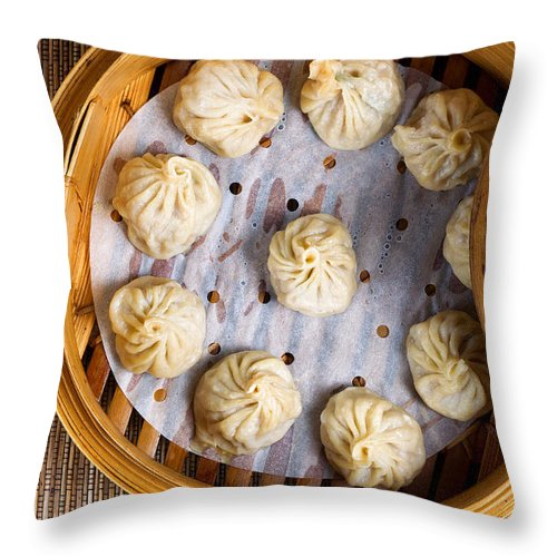 Chinese Throw Pillow featuring the photograph Freshly Cooked Dumplings Inside Of Bamboo Steamer Ready To Eat by Thomas Baker