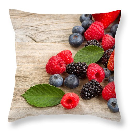 Strawberry Throw Pillow featuring the painting Freshly Picked Berries On Rustic Wooden Boards by Thomas Baker