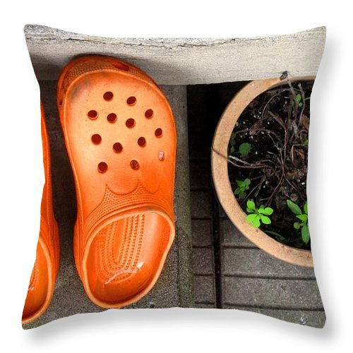 Clogs Throw Pillow featuring the photograph Garden Shoes by Ian MacDonald