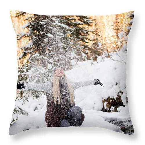Travel Throw Pillow featuring the photograph Girl Playing In The Snow In The Woods by Tamara Kirsanova