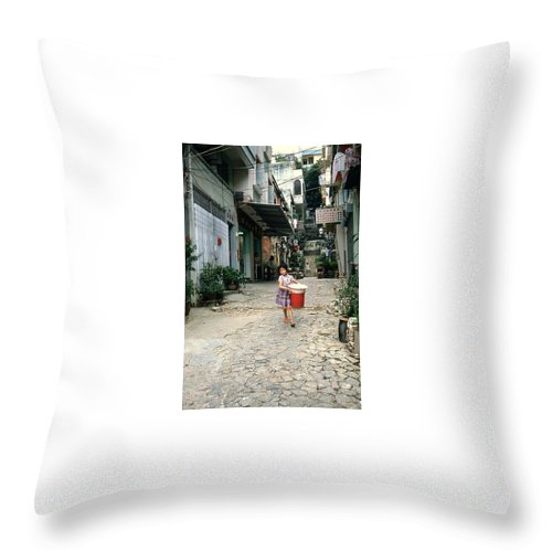 Youth Throw Pillow featuring the photograph Girl With Laundry Basket by Maro Kentros