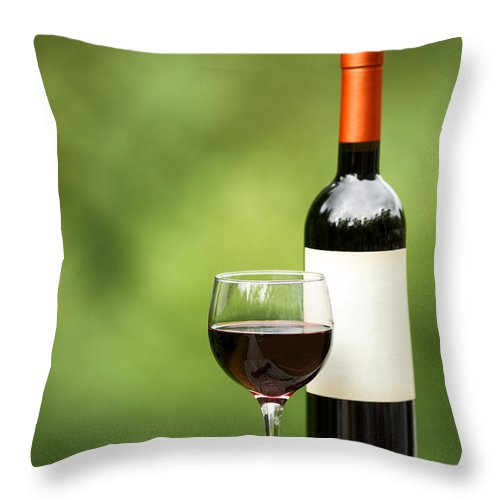 Wine Throw Pillow featuring the photograph Glass Of Red Wine Outdoors Ready To Enjoy by Thomas Baker