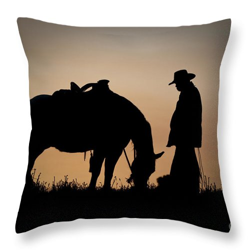 Cowboy And Horse Throw Pillow featuring the photograph Going Home by Sandra Bronstein