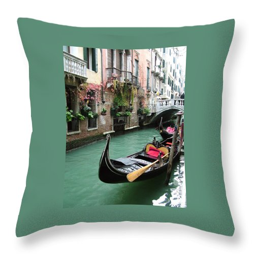 Venice Photos Throw Pillow featuring the photograph Gondola By The Restaurant by Donna Corless
