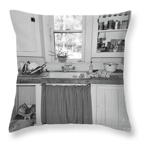 Marjorie Kinnan Rawlings Throw Pillow featuring the photograph Grandma's Kitchen B W by D Hackett
