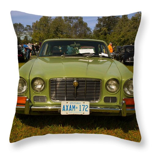 Throw Pillow featuring the photograph Green Jag by Timoke Brown