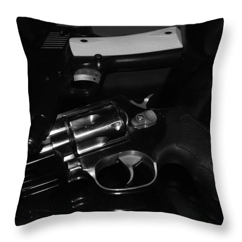 Guns Throw Pillow featuring the photograph Guns And More Guns by Rob Hans
