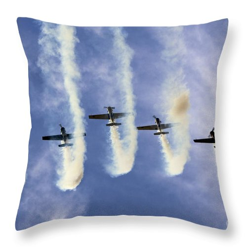 Aerostars Throw Pillow featuring the photograph Hanging On The Sky by Angel Ciesniarska