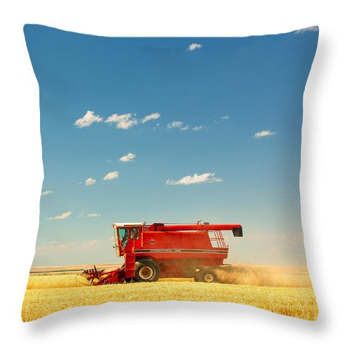 Combine Throw Pillow featuring the photograph Harvest Time by Todd Klassy