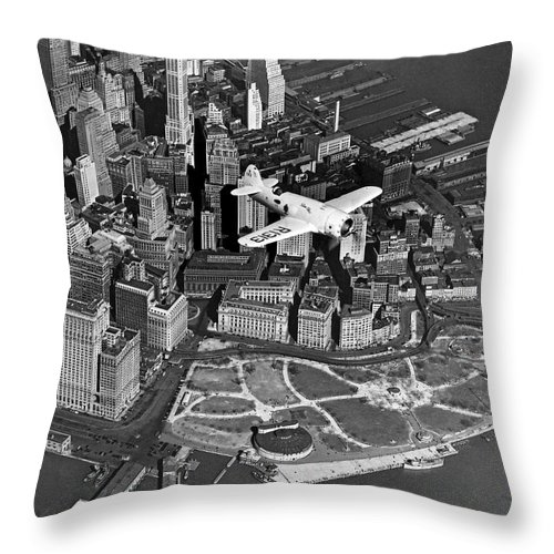 1930's Throw Pillow featuring the photograph Hawk's Plane Over Battery Park by Underwood Archives