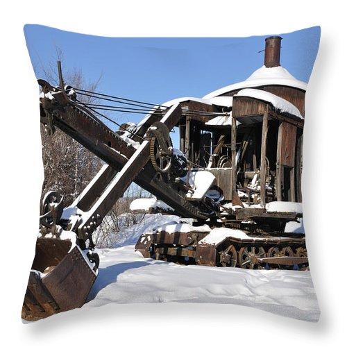 Alaska Throw Pillow featuring the photograph Historic Mining Steam Shovel During Alaska Winter by Gary Whitton