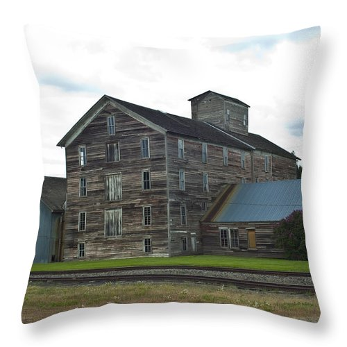 Historical Throw Pillow featuring the photograph Historical Barron Wheat Flour Mill In Oakesdale Wa by Louise Magno