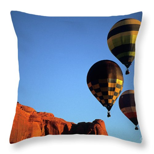 Hot Throw Pillow featuring the photograph Hot Air Balloon Monument Valley 5 by Bob Christopher
