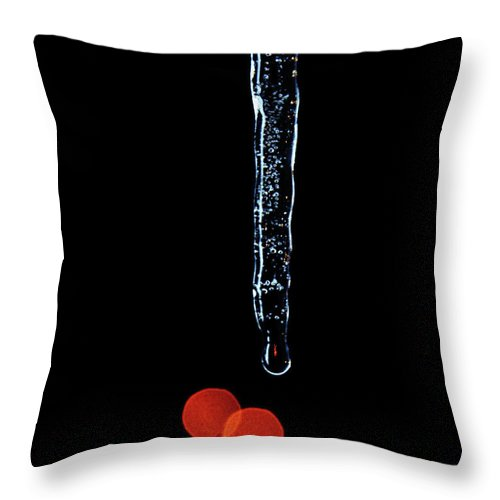 Icicles Throw Pillow featuring the photograph Icicle Drip And Red Bokah by Andee Design