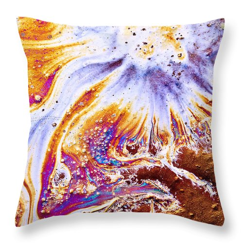 Oil Slick Throw Pillow featuring the photograph In The Beginning... by Linda McRae