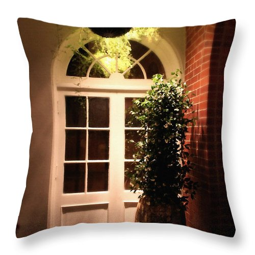 Architecture Throw Pillow featuring the photograph In The Courtyard by Todd Blanchard