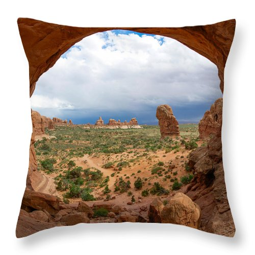 Arches National Park Throw Pillow featuring the photograph Inside Double Arch by Aaron Spong