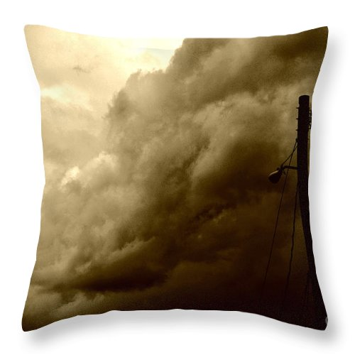 Clay Throw Pillow featuring the photograph It's Coming by Clayton Bruster