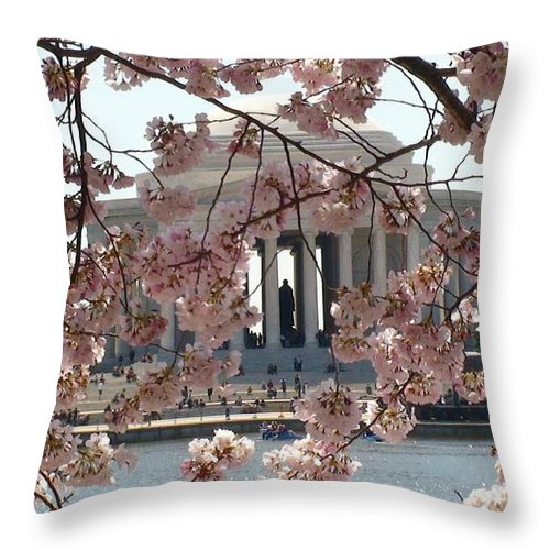 Jefferson Memorial Throw Pillow featuring the photograph Jefferson Through The Cherry Blossoms by Charles Kraus