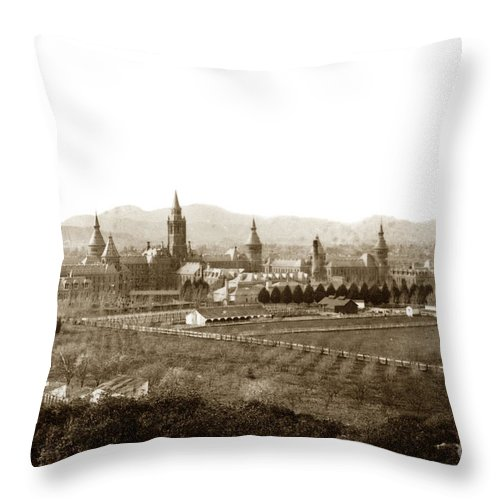 Kirkbride Throw Pillow featuring the photograph Kirkbride At Napa State Hospital In California Circa 1890 by California Views Archives Mr Pat Hathaway Archives