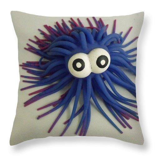 Toys Throw Pillow featuring the photograph Koosh by Anna Villarreal Garbis