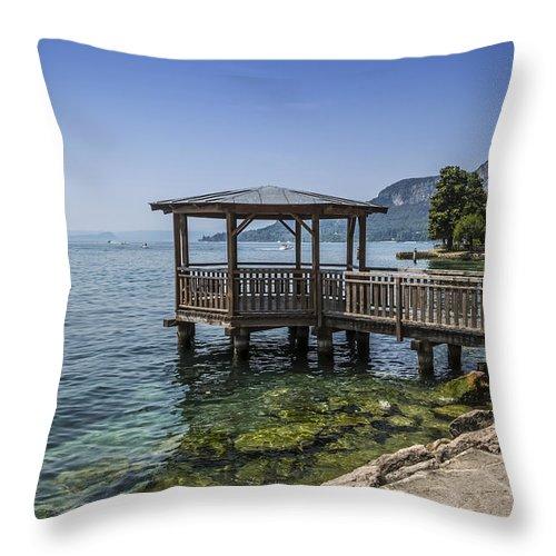 Athmospheric Throw Pillow featuring the photograph Lake Garda Riverside At Garda by Melanie Viola