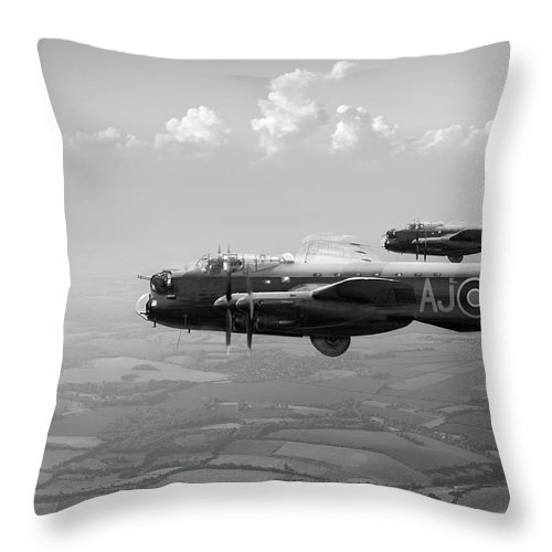 617 Squadron Throw Pillow featuring the photograph Lancasters Aj-g And Aj-n Carrying Upkeeps Black And White Versio by Gary Eason