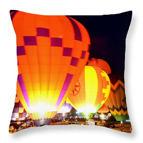 Plano Throw Pillow featuring the photograph Light Up Nite by Philip Kram