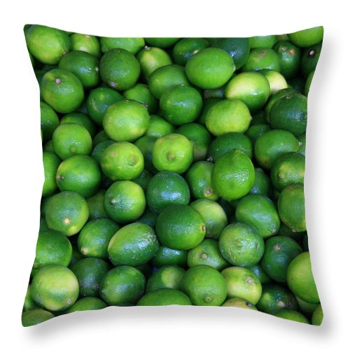 Lime Throw Pillow featuring the photograph Limes by David Dunham