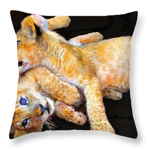 Lion Throw Pillow featuring the photograph Lion Wrestling by Michael Durst