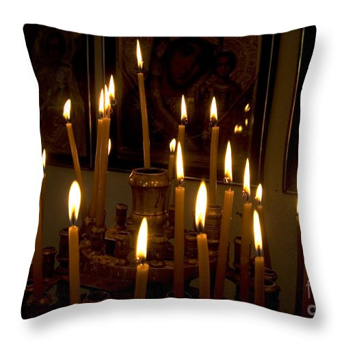 Lit Throw Pillow featuring the photograph lit Candles in church by Danny Yanai