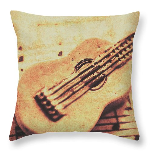 Folk Throw Pillow featuring the photograph Little Carved Guitar On Sheet Music by Jorgo Photography - Wall Art Gallery