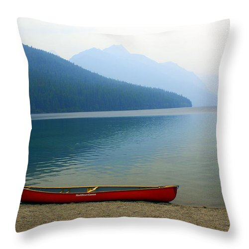 Glacier National Park Throw Pillow featuring the photograph Lonly Canoe by Marty Koch