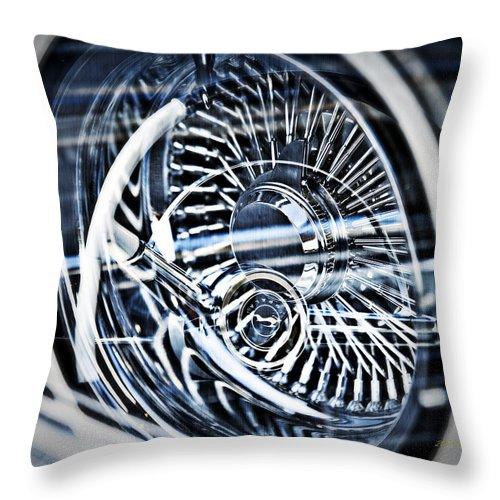 Lowrider Wheel Illusions Throw Pillow featuring the photograph Lowrider Wheel Illusions 1 by Walter Herrit