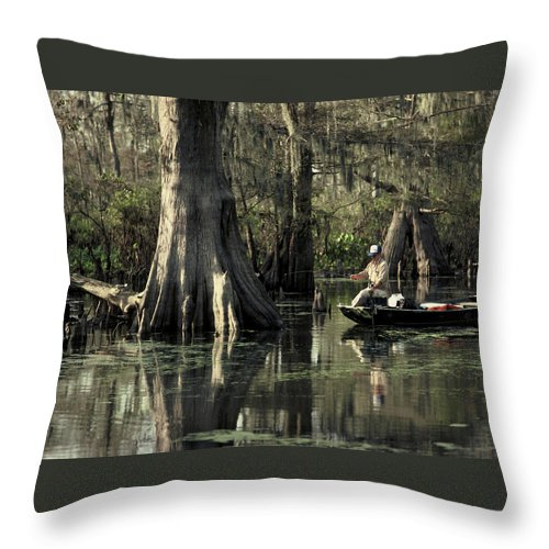 Fishing Throw Pillow featuring the photograph Man Fishing In Cypress Swamp by Herman Robert