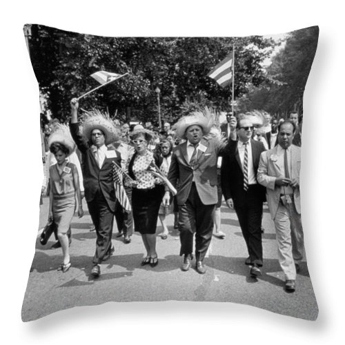 Photo Throw Pillow featuring the photograph Marchers Wearing Hats Carry Puerto Rican Flags Down Constitution Avenue by Nat Herz