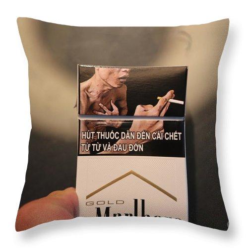 Vietnam Throw Pillow featuring the photograph Marlboro Cigarettes Pkg Vietnam by Chuck Kuhn