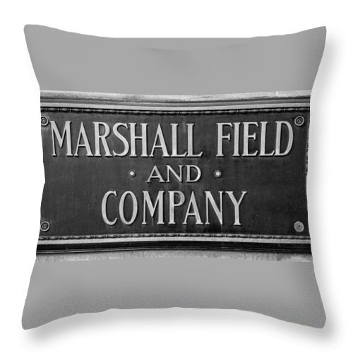 Marshall Throw Pillow featuring the photograph Marshall Field Plaque by Steve Gadomski