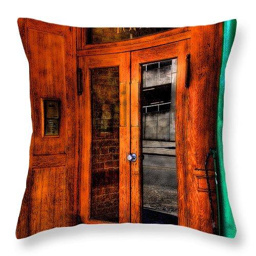 Doors Throw Pillow featuring the photograph Merchants Cafe Doors by David Patterson