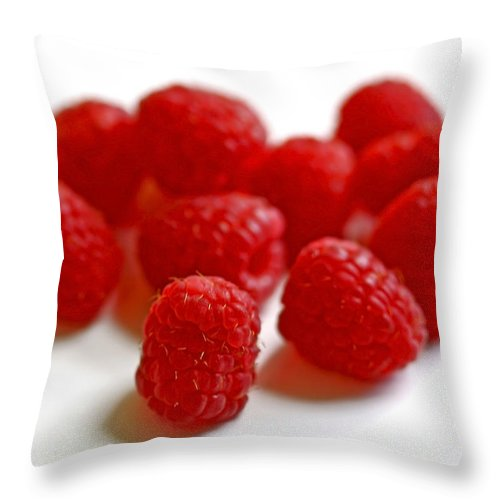 Raspberry Throw Pillow featuring the photograph Mingling by Evelina Kremsdorf