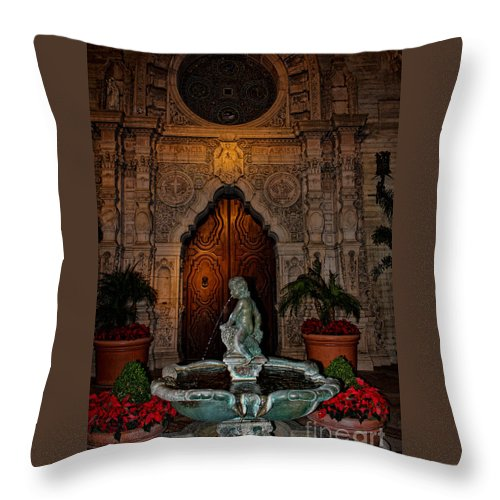 Mission Inn Throw Pillow featuring the photograph Mission Inn Chapel Fountain by Tommy Anderson