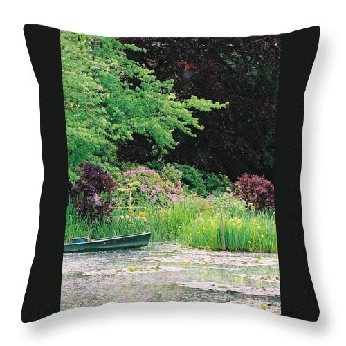 Monet Throw Pillow featuring the photograph Monet's Garden Pond and Boat by Nadine Rippelmeyer