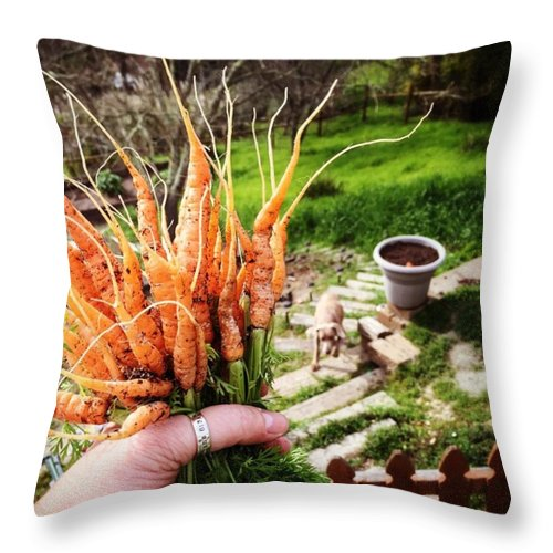 Farmtotable Throw Pillow featuring the photograph Carrot Picking by Nancy Ingersoll