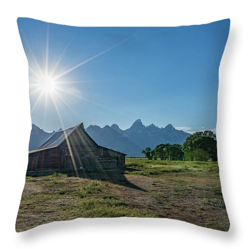 Grand Throw Pillow featuring the photograph Mormon Row by Alpha Wanderlust