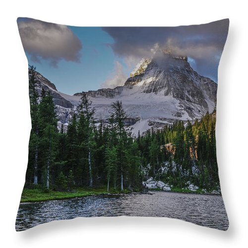 Alberta. Canada Throw Pillow featuring the photograph Mount Assiniboine In Clouds by Howie Garber