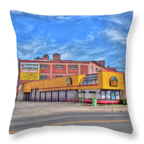 Buildings Throw Pillow featuring the photograph Mr Tire 15117 by Guy Whiteley