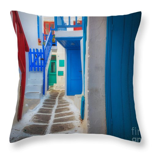 Aegean Sea Throw Pillow featuring the photograph Mykonos Alley by Inge Johnsson