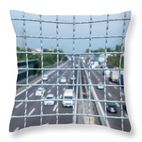 Asphalt Throw Pillow featuring the photograph Narrow Depth Of Field Looking Down From Railing Onto Busy Highway by Alexandre Rotenberg